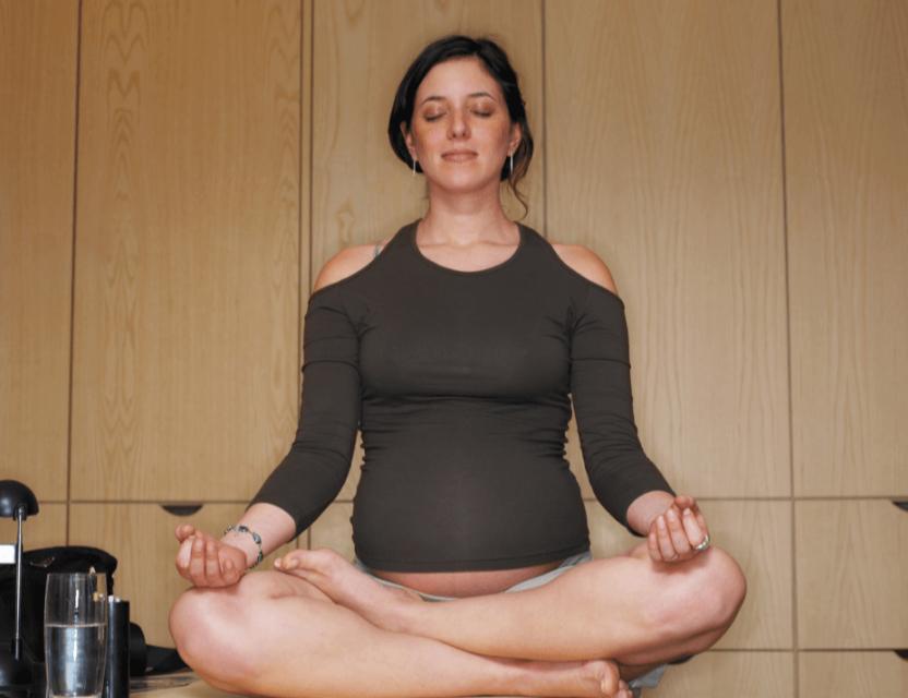 pregnant-woman-sitting-cross-legged-meditating